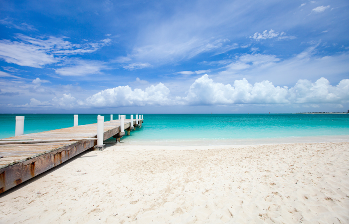 Turquoise blue waters and a white sand beach awaits in Turks & Caicos.