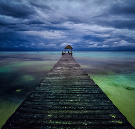 """Photo @ladzinski - A welcoming view of an isolated dock on the shores of the beautiful #MayanRiveira in the early morning hours."""
