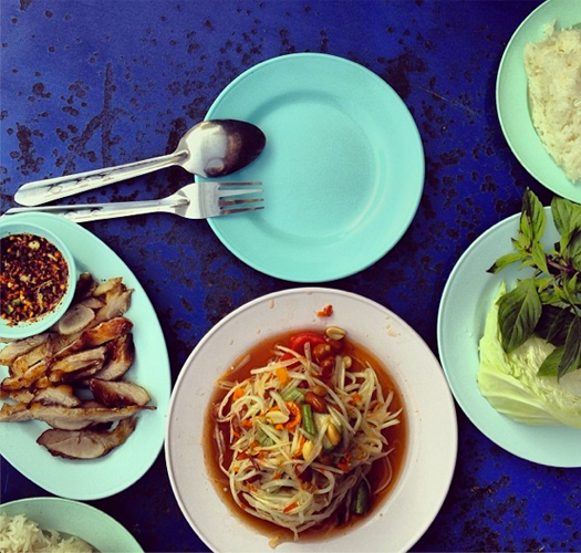 """Feasting on Isaan food, sticky rice and papaya salad, and grilled pork near my old neighbourhood."" Image courtesy @legalnomads"