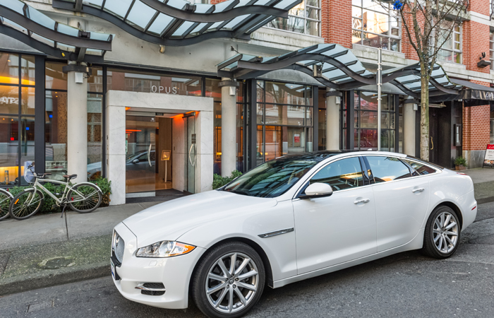 Arrange a ride in the hotel's jaguar.
