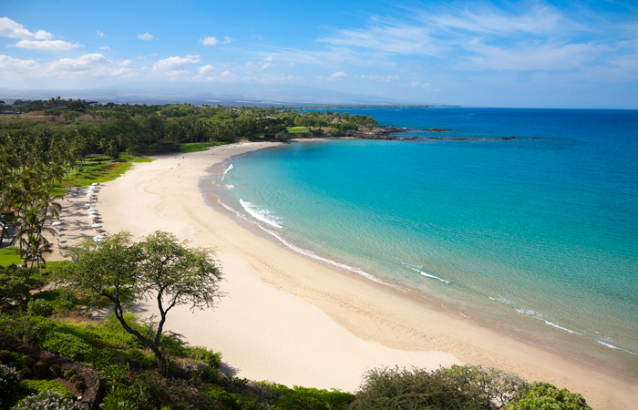 Kauna'oa Bay is a beautiful beach to swim, relax and play. Image courtesy Mauna Kea Beach Hotel.