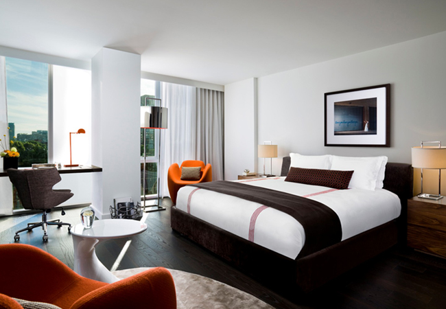 A luxurious room at the Thompson Toronto, a property available on HotelTonight.