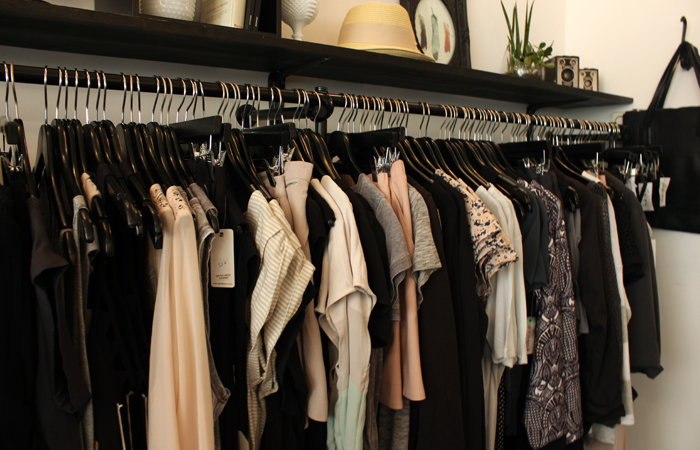 Rack of clothes hand at Unicorn Boutique in Montreal.