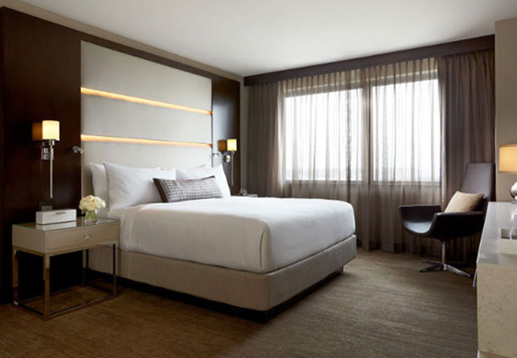 The plush rooms at the JW Marriott make resting in between shopping super comfy. Photo courtesy of the JW Marriott.
